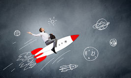 Man on rocket. Young businessman,an flying in sky on drawn rocket Royalty Free Stock Photos