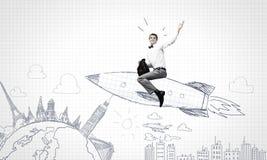 Man on rocket Stock Images