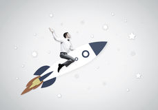 Man on rocket Stock Images