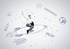 Man on rocket Stock Photography