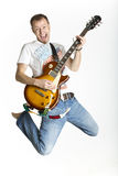 Man is rocking on electric guitar Royalty Free Stock Images