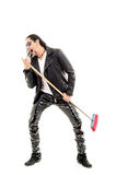 Man Rocking Out with broom Royalty Free Stock Photos