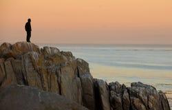 Man on rocks Stock Images