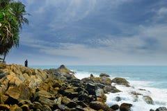 Man on a rocky shore Stock Photos