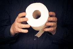 Man roll toilet paper Stock Photography