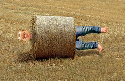 Free Man Rolled Up In Farming Hay Bale Accident Stuck Between A Rock And A Hard Place Stock Image - 143959051