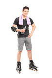 Man on roller skates holding a water bottle Royalty Free Stock Images