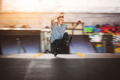Man on rollerblades doing trick. Royalty Free Stock Photo