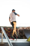 Man on rollerblades. Young male outdoors. In love with extreme sports Stock Photo