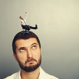 Man rolling on the big head. Small laughing man rolling on the big head Stock Photography