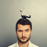 Man rolling on the head big dissatisfied man Royalty Free Stock Photo