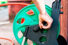 Man rolling up garden hose Royalty Free Stock Photo