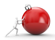 Man rolls christmas ball Royalty Free Stock Images