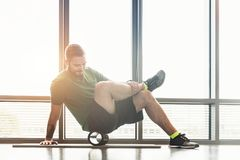 Man rolls his muscules in front of a window Royalty Free Stock Photos
