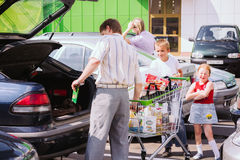 Man Rolls The Shopping Cart On The Parking Stock Photography