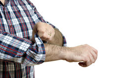 Man rolls up sleeves Royalty Free Stock Photo