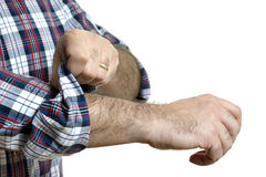 Man rolls up sleeves Stock Photos