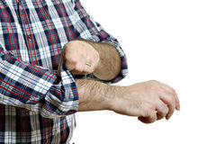 Man rolls up sleeves Stock Photography
