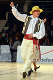 Man in Romanian national outfit perform during dancesport competition Stock Photography