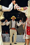 Man in Romanian traditional outfit perform during dancesport competition Stock Image