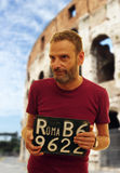 Man with Rome car plate Royalty Free Stock Photography