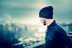 Man on the roof of the high building Royalty Free Stock Image