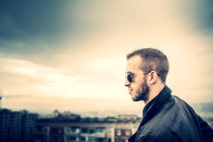 Man on the roof of the high building Stock Image