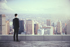 Man on the roof and looking at the city with skyscrapers Royalty Free Stock Photo
