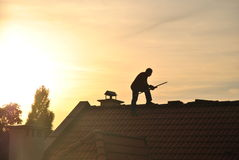 Man on a roof Stock Images