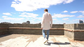 The man on the roof. Slow mo. Stedicam shot. Camera is moving stock video footage