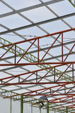 A man on a roof. Roof structure of a building which there was a man climbing unsafely on it Stock Photo