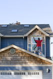 Man on Roof - Vertical Royalty Free Stock Image