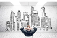 Man in room with city sketch Stock Photo