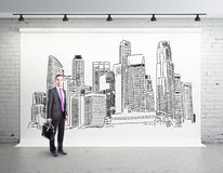Man in room with city sketch Stock Photos