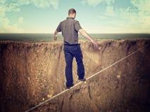 Man on rope. Caucasian man walk on rope like acrobat Royalty Free Stock Photos
