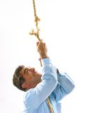 Man on the rope attached Royalty Free Stock Image