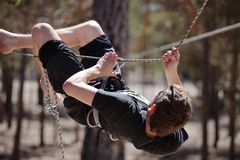 Man on rope course Stock Photo