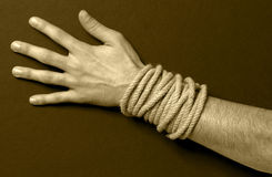 Man with a rope in his hand. Sepia tone Stock Image