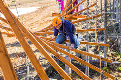 A man in a ropes course. The man climbs into ropes course Royalty Free Stock Images