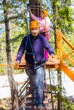 A man in a ropes course. The men climbs into ropes course Stock Photography