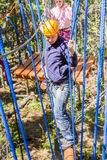 A man in a ropes course. The men climbs into ropes course Royalty Free Stock Photo