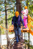 A man in a ropes course. The men climbs into ropes course Royalty Free Stock Photography