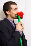 Man with rose Stock Images