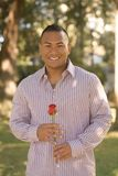 Man with Rose. Asian Man Holding a Red Rose royalty free stock photos