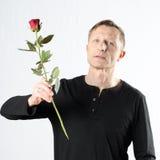 Man with rose Stock Photos