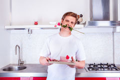 Man with rose in his mouth Stock Images