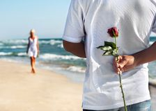 Man with rose waiting his woman Royalty Free Stock Photos