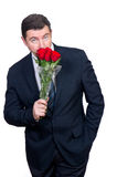 Man with roses Stock Images