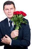 Man with roses Royalty Free Stock Images