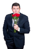 Man with roses Royalty Free Stock Photography